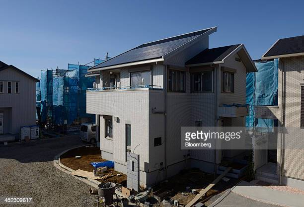 New houses stand under construction at Fujisawa Sustainable Smart Town , developed by Panasonic Corp., in Fujisawa, Kanagawa Prefecture, Japan, on...