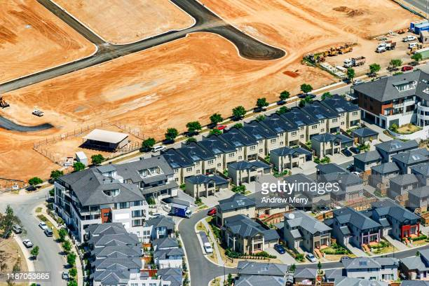 new housing development with abstract pattern in dirt, sydney, australia, aerial photography - housing development stock pictures, royalty-free photos & images