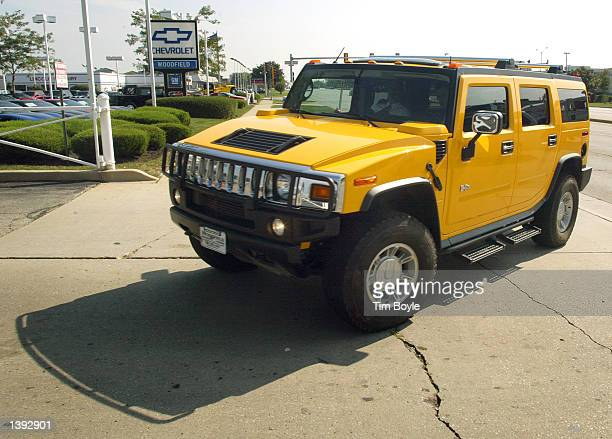 SCHAUMBURG IL SEPTEMBER 18 A new Hummer SUV is reflected in another Hummer SUV's window displaying its $117950 sticker price September 18 2002 at...
