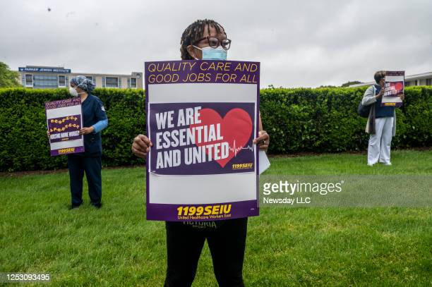 Employees a Parker Jewish Institute for Health Care and Rehabilitation in New Hyde Park, New York during a vigil on May 28, 2020 to protest their...