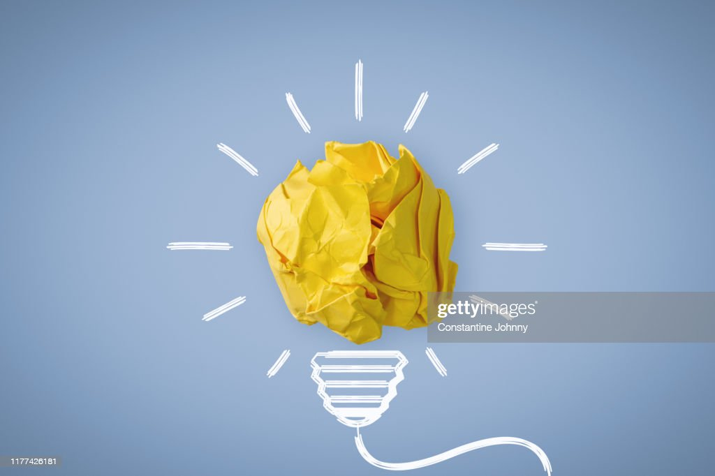 New Idea. Crumpled Paper Ball Glowing Bulb Concept. : Photo