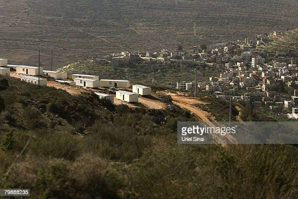 A new illegal outpost neighbourhood is constructed on February 21 2008 in the Jewish settlement of Eli West Bank Twentyseven mobile homes are being...