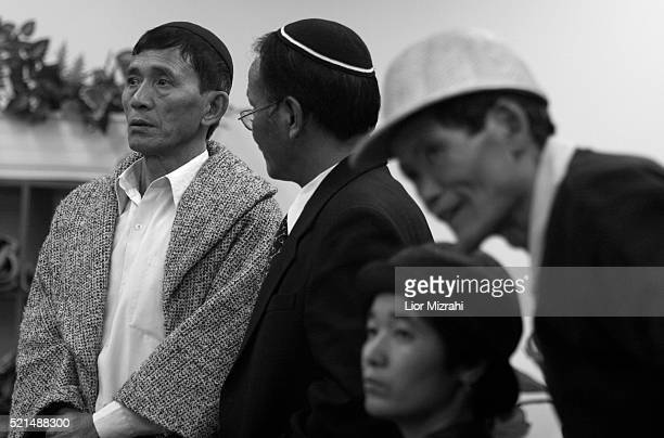 New immigrants from the 'Bnei Menashe' tribe wait to Israeli officials after arrives in Ben Gurion International Airport in Lod as they emigrate from...