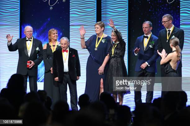 New inductees Alan Moffat Drew Ginn Darren Lockyer Sam Coffa Gai Waterhouse Wendy Botha and Robyn Maher look on on stage at the 2018 Sport Australia...