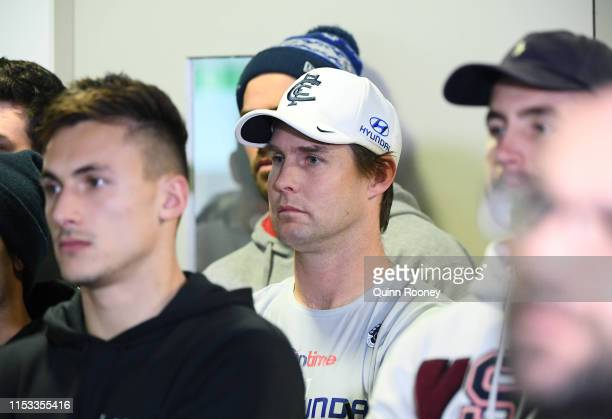 New interim coach David Teague watches on with Carlton players as Brendon Bolton speak to the media during a Carlton Blues AFL media opportunity at...