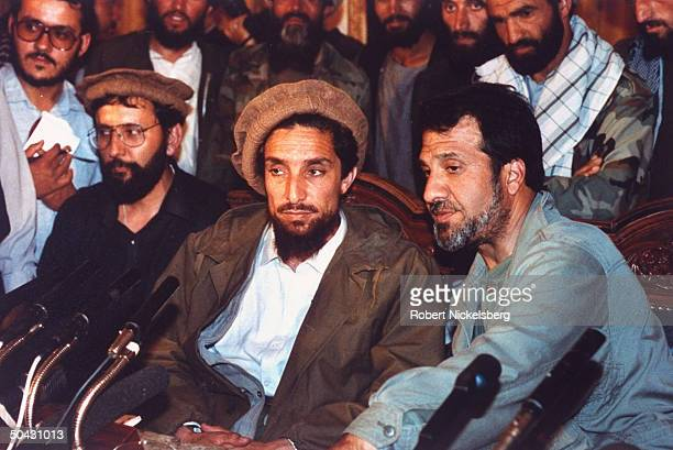 New interim govt Def Min Ahmed Shah Massoud top mil ldr of mujahedin forces who defeated Najibullah regime speaking flanked framed by others