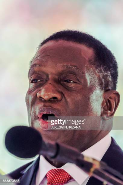 New interim Zimbabwean President Emmerson Mnangagwa is officially swornin by the Chief judge of the Supreme Court during a ceremony in Harare on...