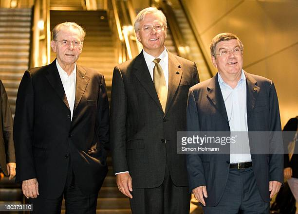 New IOC President Thomas Bach Jacques Rogge and Lufthansa CEO Christoph Franz pose during their arrival at Frankfurt Airport on September 12 2013 in...