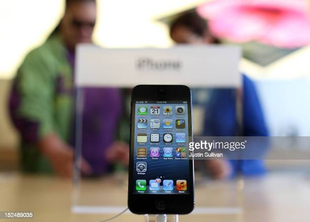 A new iPhone 5 is displayed at an Apple Store on September 21 2012 in San Francisco California Customers flocked to Apple Stores across the US to...