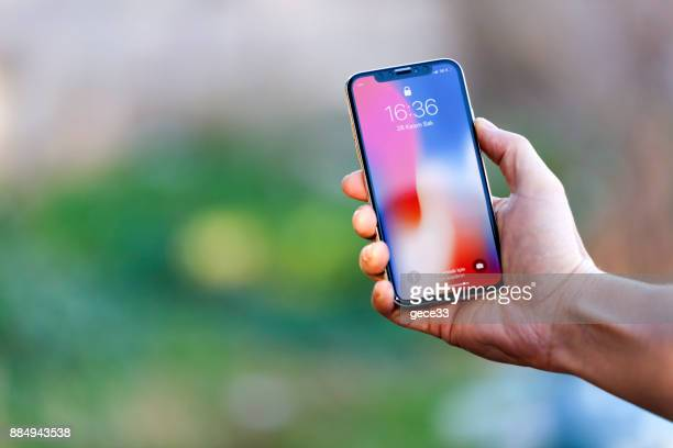 new iphone x silver - smartphone stock pictures, royalty-free photos & images