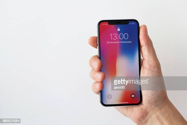 new iphone x silver - letter x stock pictures, royalty-free photos & images