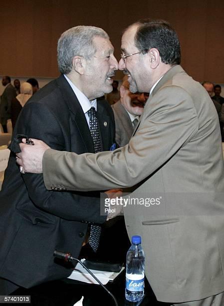 New Iraqi Prime Minister Jawad alMaliki greets parliamentarian Abd Mutlak Jabbori during the second session of the parliament on April 22 2006 in...