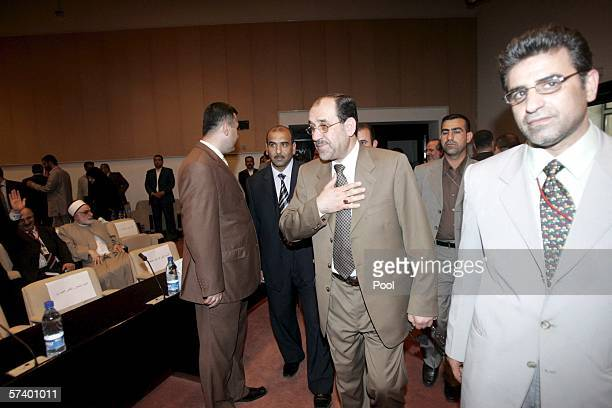 New Iraqi Prime Minister Jawad alMaliki greets the members of the parliament during the second session of the parliament on April 22 2006 in Baghdad...
