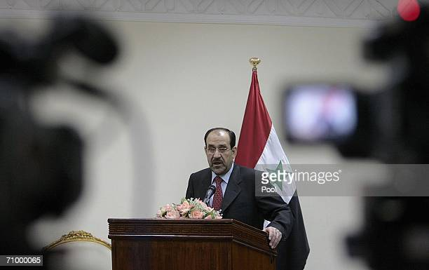 New Iraqi Prime Minister Nuri alMaliki addresses journalists during a press conference after the first meeting of his cabinet May 21 2006 in Baghdad...