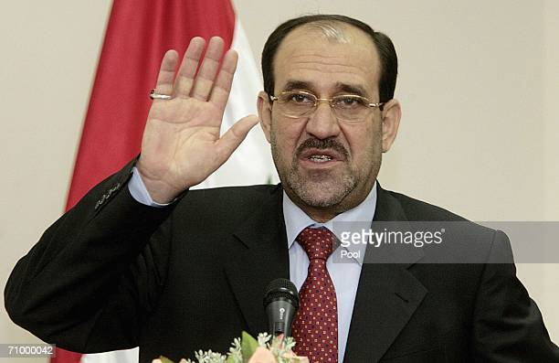 New Iraqi Prime Minister Nuri alMaliki gestures during a press conference after the first meeting of his cabinet May 21 2006 in Baghdad Iraq Maliki...