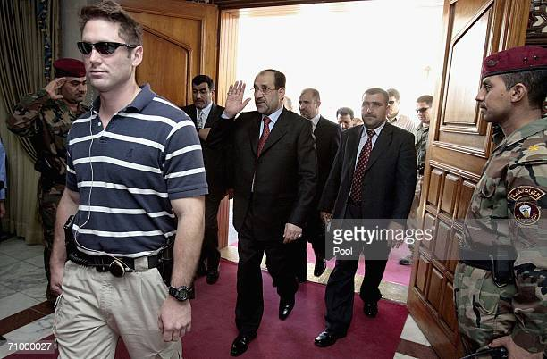New Iraqi Prime Minister Nuri alMaliki salutes as he arrives to his office May 21 2006 in Baghdad Iraq Maliki announced plans for renewed security...