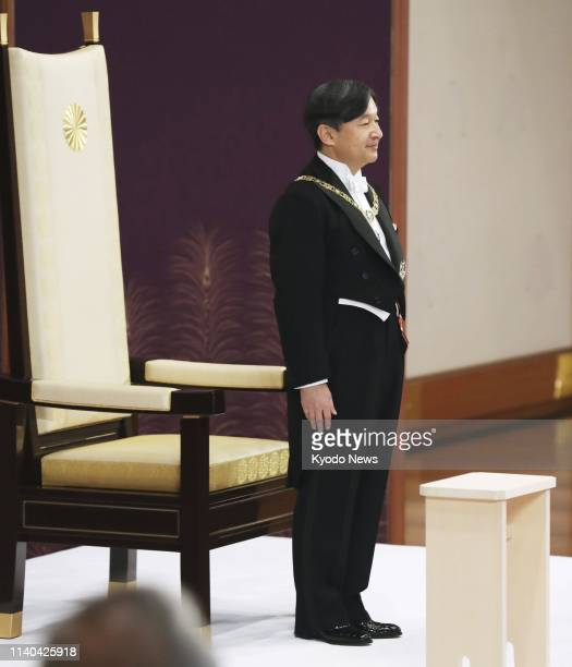 New Japanese Emperor Naruhito stands on dais to inherit the imperial regalia of sword and jewel at the Imperial Palace in Tokyo on May 1 2019 ==Kyodo
