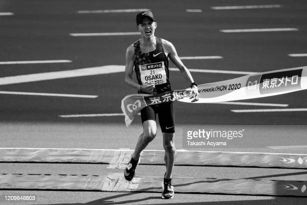 New Japanese national record holder Suguru Osako of Japan celebrates as he crosses the finish line to take fourth place in the men's competition...