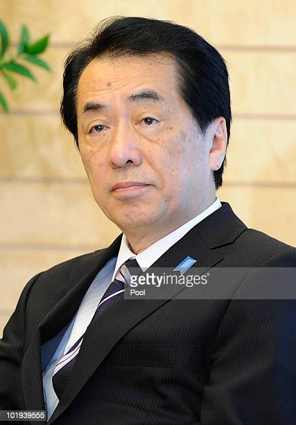 New Japanese Prime Minister Naoto Kan looks on during a meeting with relatives of Japenese people abducted by North Korea at the prime minister's...