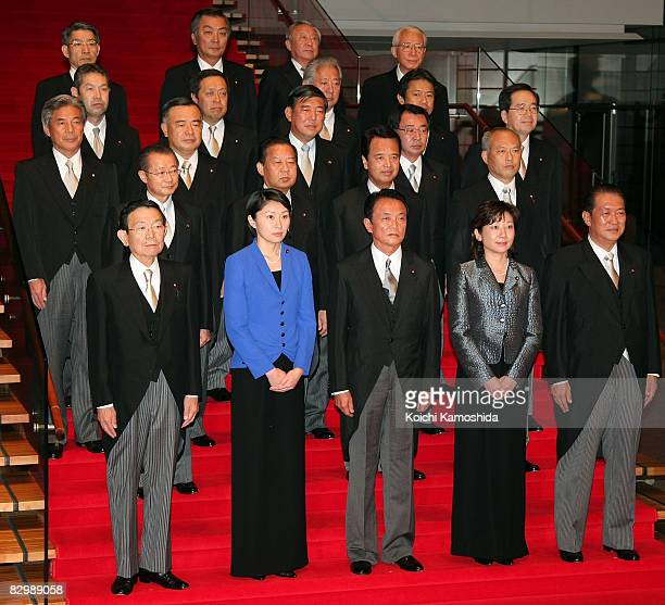 New Japanese Prime Minister Taro Aso and his new cabinet members pose for photographs at Prime Minister's official residence at the Prime Minister's...