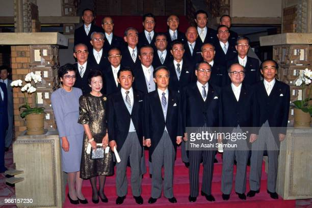 New Japanese Prime Minister Toshiki Kaifu and his cabinet members pose for photographs at the prime minister's official residence on August 10 1989...