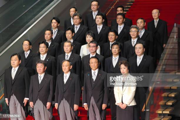 New Japanese Prime Minister Yoshihide Suga and his cabinet members attend a family photo session after their first cabinet meeting at the prime...