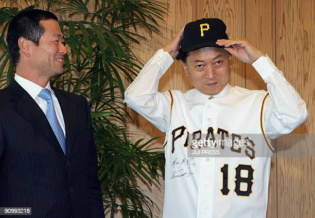 New Japanese Prime Minister Yukio Hatoyama puts on a Pittsburgh Pirates baseball hat and jersey as Japanese League and Major League Baseball Pirates...