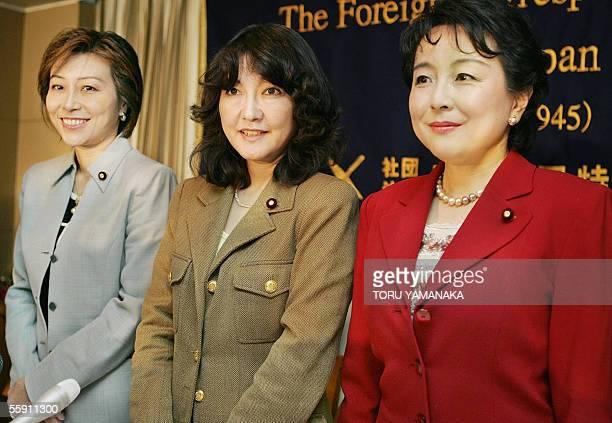New Japanese representatives Yukari Sato Satsuki Katayama and Kuniko Inoguchi smile as they pose for photographers before a press conference at the...
