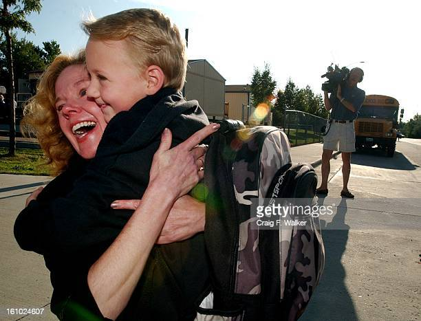 New Jeffco Schools Superintendent Cindy Stevenson gets a hug from first grader Lonnie Goodwin as she greets students on the first day of class at her...