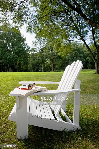 USA, New Jersey, Adirondack chair on lawn