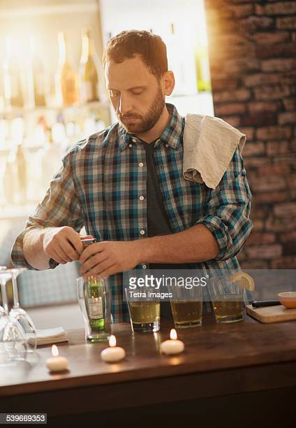 USA, New Jersey, Bartender opening bottle