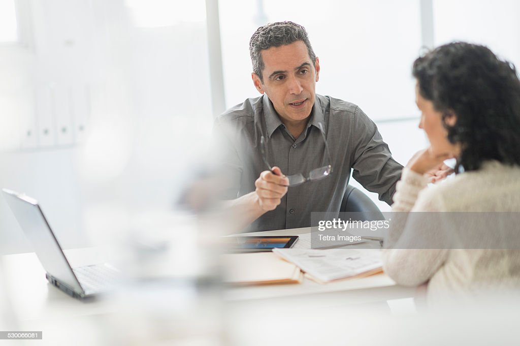 USA, New Jersey, Business people talking at desk in office : Stock Photo