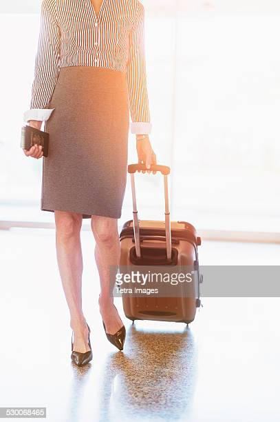 USA, New Jersey, Businesswoman at airport