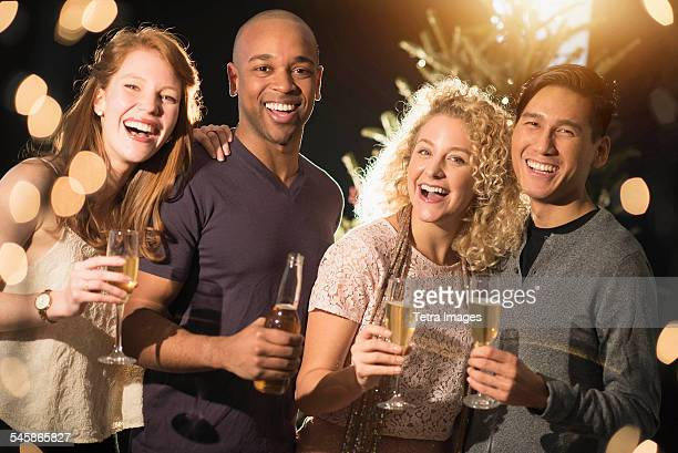 USA, New Jersey, Cheerful friends celebrating New Years Eve