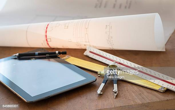 USA, New Jersey, Close up of desk with plans, ruler, digital tablet and contractor