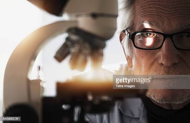 USA, New Jersey, Close up of man behind microscope