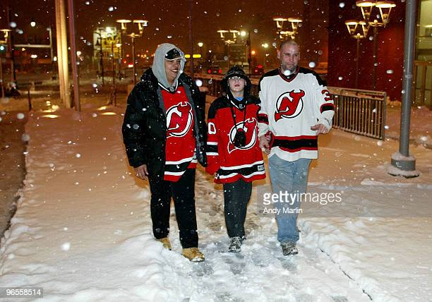 New Jersey Devil fans brave the blizzard conditions to watch the game between the Philadelphia Flyers and the New Jersey Devils at the Prudential...