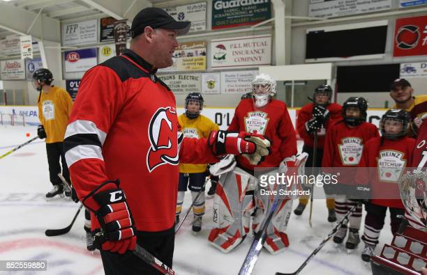 O'LEARY PE SEPTEMBER 23 New Jersey Devils alumni Colin White speaks to minor league hockey players as he takes part in the on ice clinic during NHL...
