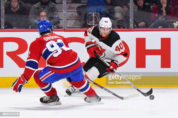 New Jersey Devils Center Blake Coleman stops on the ice while controlling the puck in front of Montreal Canadiens Center Jonathan Drouin during the...
