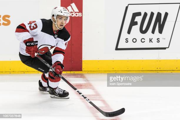 New Jersey Devils Center Brett Seney takes the puck across center ice during the second period of a regular season NHL game between the New Jersey...