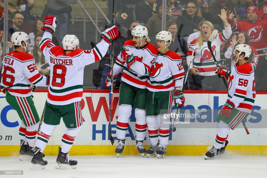 New Jersey Devils center Brian Boyle celebrates with teammates after ... fcb60fa17
