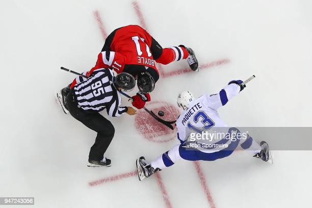 New Jersey Devils center Brian Boyle faces off against Tampa Bay Lightning center Cedric Paquette during the First Round Stanley Cup Playoff Game 3...