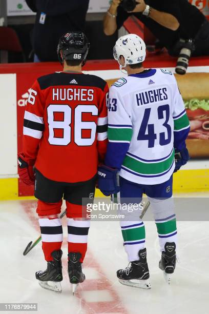 New Jersey Devils center Jack Hughes and his brother Vancouver Canucks defenseman Quinn Hughes prior to the National Hockey League game between the...