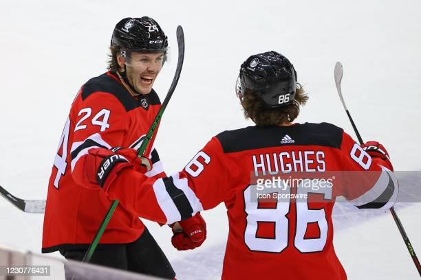 New Jersey Devils center Jack Hughes celebrates with teammate New Jersey Devils defenseman Ty Smith after scoring during the first period of the...