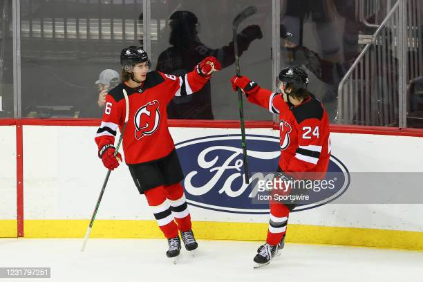 New Jersey Devils center Jack Hughes celebrates with teammate New Jersey Devils defenseman Ty Smith after scoring during the first oeriod of the...