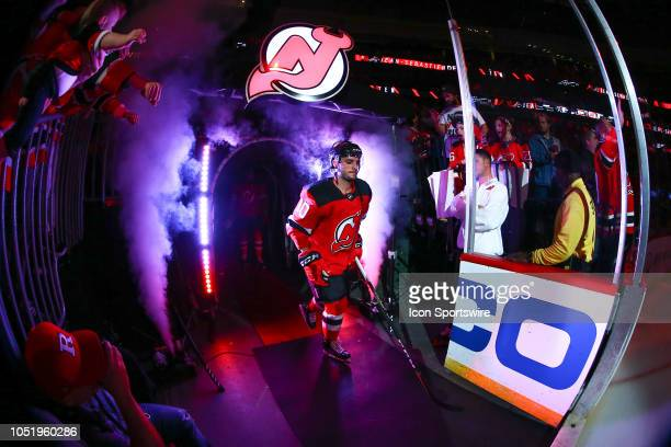 New Jersey Devils center Jean-Sebastien Dea enters the ice during player introductions prior to the National Hockey League Game between the New...