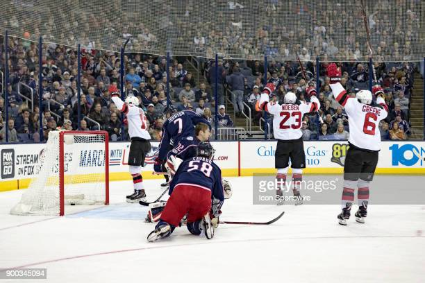 New Jersey Devils center Nico Hischier New Jersey Devils right wing Stefan Noesen and New Jersey Devils defenseman Andy Greene celebrate after a goal...