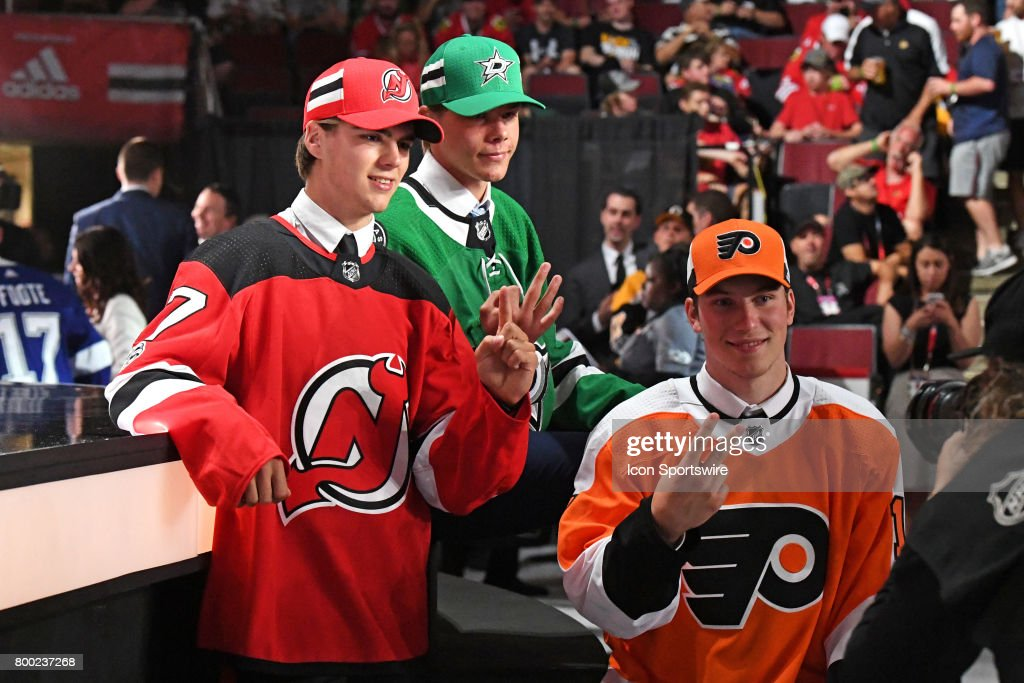 New Jersey Devils center Nico Hischier (left), Philadelphia Flyers select center Nolan Patrick (right), and Dallas Stars select defenseman Miro Heiskanen (center) pose for a photo after being selected in the first round of the 2017 NHL Draft on June 23, 2017, at the United Center, in Chicago, IL.