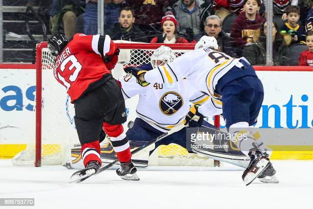 New Jersey Devils center Nico Hischier shoots during overtime of the National Hockey League Game between the New Jersey Devils and the Buffalo Sabres...