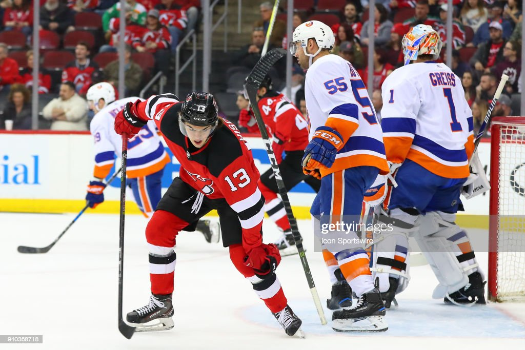 New Jersey Devils center Nico Hischier takes the stick out of the ... d3c037ec4fe